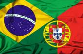 Waving flag of Portugal and Brazil — Stock Photo