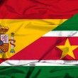 Waving flag of Suriname and Spain — Stock Photo #64247411