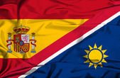 Waving flag of Namibia and Spain — Stock Photo