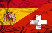 İsviçre ve İspanya bayrağı sallayarak — Stok fotoğraf