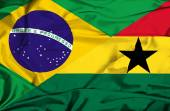 Waving flag of Ghana and Brazil — Stock Photo