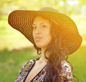 Portrait of beautiful attractive woman with straw hat — Stock Photo