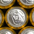 Abstract vie of cold cans with refreshing drink background — Stock Photo #71068545