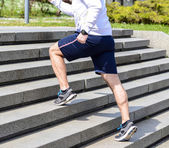 Practice - Close up of young man running up the stairs — Stock Photo