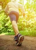 Runner feet running on road closeup on shoe — Stock Photo