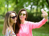 Friends making selfie on beautiful summer day in park — Stock Photo