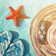 Straw hat, glasses, sea star and flip-flop sandals - Vacation co — Stock Photo #72918913