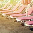 Pink sunbeds at beach — Stock Photo #72919883