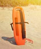 Lifeguard standing in the sand — Stock Photo