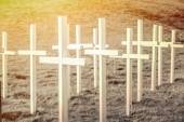 Wooden cross on field — Stock Photo