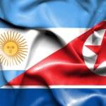 Waving flag of North Korea and Argentina — Stock Photo #74578887