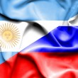 Waving flag of Russia and Argentina — Stock Photo #74579157
