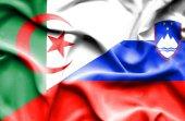 Waving flag of Slovenia and Algeria — Stock Photo