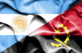 Waving flag of Angola and Argentina — Stock Photo