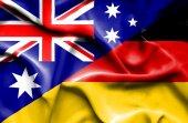 Waving flag of Germany and Australia — Stock Photo