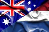 Waving flag of Netherlands and Australia — Stock Photo