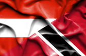 Waving flag of Trinidad and Tobago and Austria — Stock Photo
