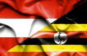 Waving flag of Uganda and Austria — Stock Photo