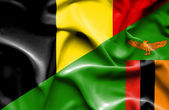 Waving flag of Zimbabwe and Belgium — Stock Photo