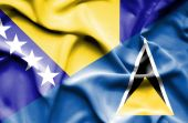 Waving flag of St Lucia and Bosnia and Herzegovina — Stock Photo