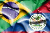 Waving flag of Belize and Brazil — Stock Photo