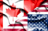 Waving flag of United States of America and Canada — Stock Photo