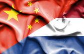 Waving flag of Netherlands and China — Stock Photo
