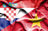 Waving flag of Vietnam and Croatia — Stock Photo
