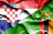 Waving flag of Zimbabwe and Croatia — Stock Photo