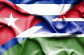 Waving flag of Gambia and Cuba — Stock Photo