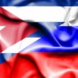 Waving flag of Russia and Cuba — Stock Photo #74765363