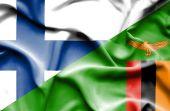 Waving flag of Zimbabwe and Finland — Stock Photo