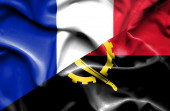 Waving flag of Angola and France — ストック写真