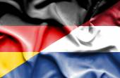 Waving flag of Netherlands and Germany — Stock Photo