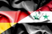 Waving flag of Syria and Germany — Stock Photo
