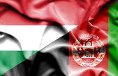 Waving flag of Afghanistan and Hungary — Stockfoto