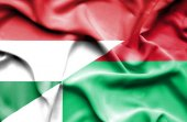 Waving flag of Madagascar and Hungary — Стоковое фото