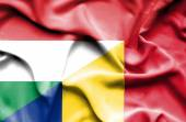 Waving flag of Romania and Hungary — ストック写真