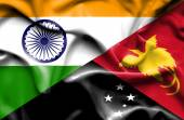 Waving flag of Papua New Guinea and India — Stockfoto