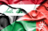 Umman ve Irak bayrağı sallayarak — Stok fotoğraf
