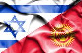 Kırgızistan ve İsrail bayrağı sallayarak — Stok fotoğraf