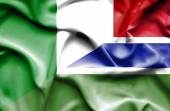 Waving flag of Gambia and Italy — Stock Photo
