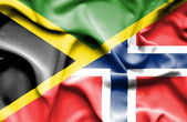 Waving flag of Norway and Jamaica — Stock Photo