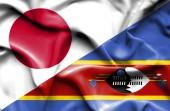 Waving flag of Swazliand and Japan — Stock Photo