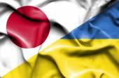 ウクライナと日本の旗を振っています。 — ストック写真