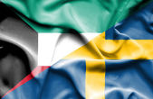 Waving flag of Sweden and Kuwait — Stockfoto