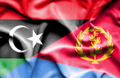 Waving flag of Eritrea and Libya — Stock Photo