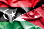Waving flag of Jordan and Libya — Stok fotoğraf