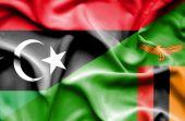 Waving flag of Zimbabwe and Libya — Stock Photo