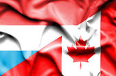 Waving flag of Canada and Luxembourg — Stock Photo